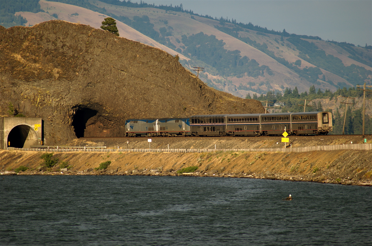Eastbound Portland section of Empire Builder cruises by boat launch.