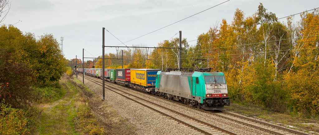 2804 has an intermodal in two in a very colorful scene from fall 2015 in Remersdaal.