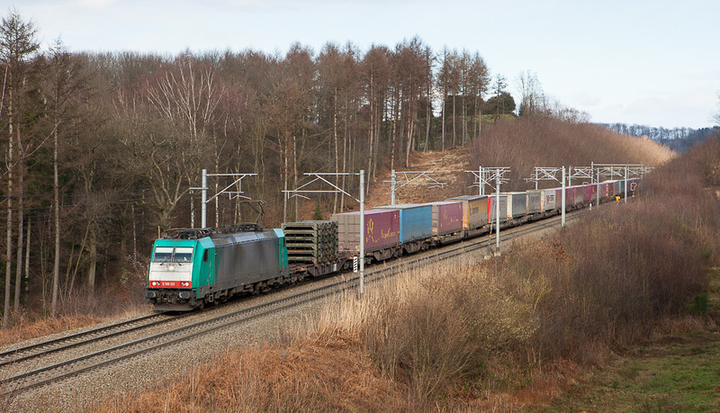 Railtraxx 2801 brings an intermodal from Curtici/Romania west approaching the Rue d'Aix underpass in Moresnet.