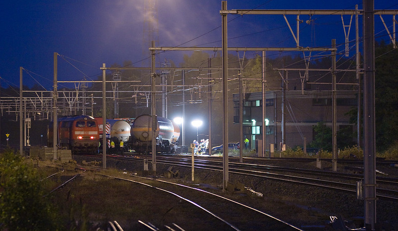 A freight train derailed several tank cars at tower 16 in Montzen yard on 10-Jul-2008. By dusk the hazmat cargo had been transloaded and rerailing operations were under way.