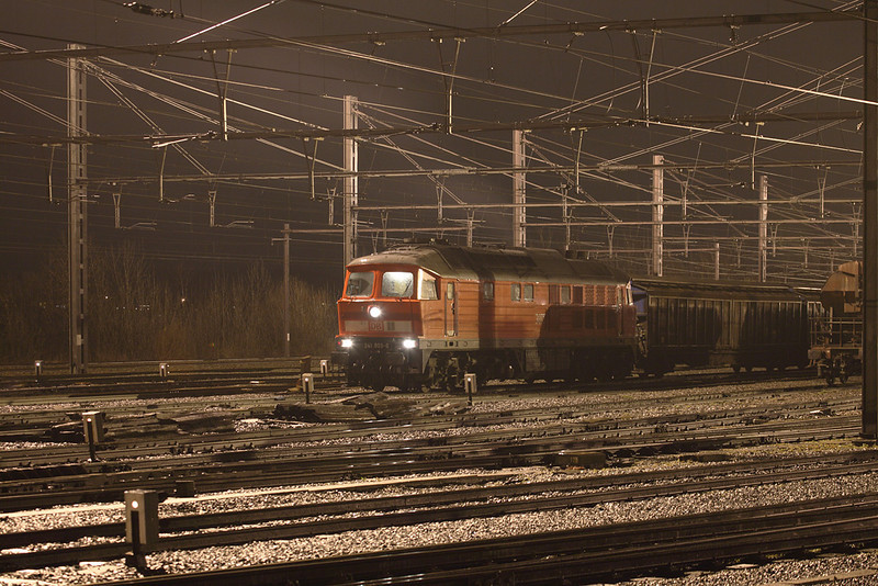Winter time - night shot time. Here's 241 803 with a UK-bound train composed of ferry wagons in Montzen near tower 14. In the pouring rain. These units were transferred to eastern Germany in mid-December 2008.