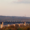 2841 leading empty limestone train 48566 (Oberhausen/D - Hermalle s/Huy) across the viaduc de Moresnet. Hot air balloons are popular in this area.