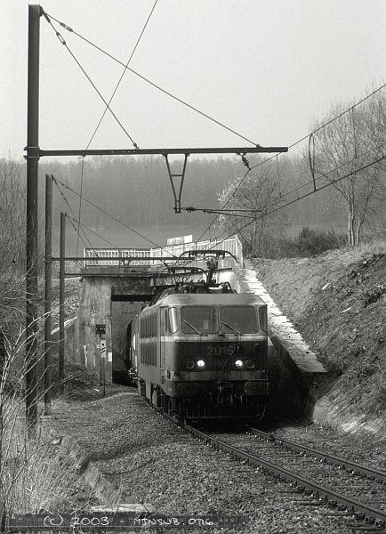 In a view from 2003 2016 brings an eastbound train under the old L38 overpass on the yard lead into Montzen for a power change to diesel.