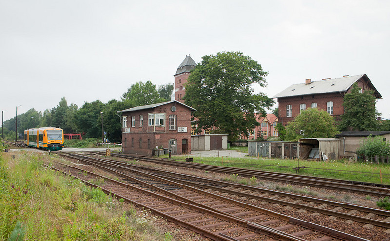 ODEG VT 650.064 forming OE64 to Goerlitz arrives at Niesky. The timeless arrangement of water tower, railroad workers house, and interlocking tower dates from the second half of the 19th century. The crossing gates are still operated manually from the tower.