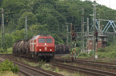 HGK DE13 with a tank train in Köln-West. This is the last surviving operating unit of only three MaK-built DE1024s. The units were built for heavy mainline service in non-electrified territory in northern Germany but suffered lots of problems, including a number of fires, throughout their career. They bounced around private operators after DB didn't like them and ended up with HGK. Two of the three have burned again and are stored unservicable.  Köln-West is a hotspot of freight and passenger activity. If you ever come to Köln and can only spend a couple of hours foaming, this is the place to go.