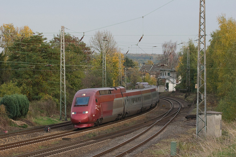 The Thalys high speed train is a variant of the French TGV, running between Cologne and Paris-Nord by way of Brussels. Here one rushes through the large curve at Eschweiler at a pretty good clip. The dome on the second car conceals the satellite uplink for in-train Internet access.