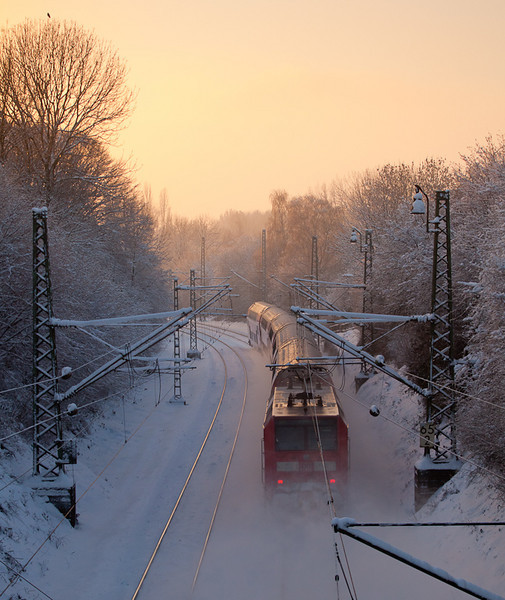 RE1 hustling through Eilendorf and into the setting sun on the shortest day of the year 2010.