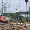 Gremberg yard in Köln is the major freight hub in the area. A large number of freight trains are serviced here daily, and a good number also start and terminate here. In addition, the north-south main line skirting the yard hosts a good variety of trains not making setouts/pickups. The north yard throat is the busier end and has nice sight lines, including Gnf tower in this view.<br /> <br /> Here's 155 181 with the Ambrogio train TEC 40084 (Gallarate/I - Muizen/B) bypassing the yard on its way to Aachen and on into Belgium.