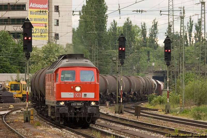This mixed freight is heavy with tank cars as it passes through München Ost.