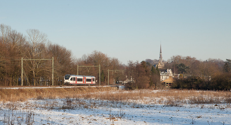 A Veolia Stadler Gtw 2/6 heads for Maastricht after completing its station stop in Meerssen.