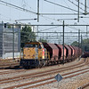 "Railion-NL 6411 ""Olivier"" with a train of empty fertilizer hoppers for DSM Agro in Sittard."