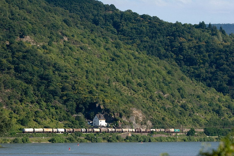 A Rail4Chem tank car train heads upriver south of Kaub. The hills dwarf the train.