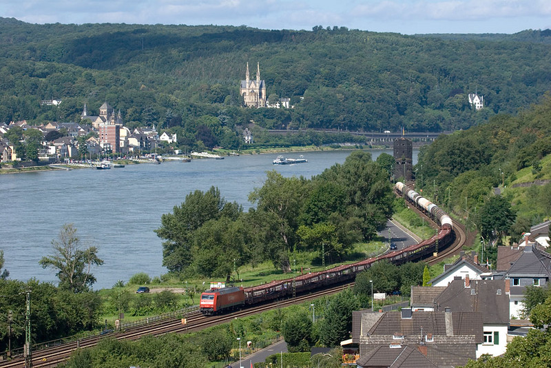"""Scenic views are what the Rhein valley is all about. This mixed freight has just passed the site of the famous <a href=""""http://en.wikipedia.org/wiki/Remagen#The_Bridge_at_Remagen"""">Remagen Bridge</a> (the dark tower in the background) on its southbound journey. This photo was taken from the <a href=""""http://www.rheinsteig.de/index.php?id=2&L=1"""">Rheinsteig</a> trail."""