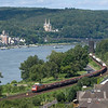 "Scenic views are what the Rhein valley is all about. This mixed freight has just passed the site of the famous <a href=""http://en.wikipedia.org/wiki/Remagen#The_Bridge_at_Remagen"">Remagen Bridge</a> (the dark tower in the background) on its southbound journey. This photo was taken from the <a href=""http://www.rheinsteig.de/index.php?id=2&L=1"">Rheinsteig</a> trail."