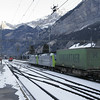 A BLS Cargo intermodal train with doubleheaded Re485s has been sidelined for a faster passenger train in Kandersteg, south of the Lötschberg Tunnel.