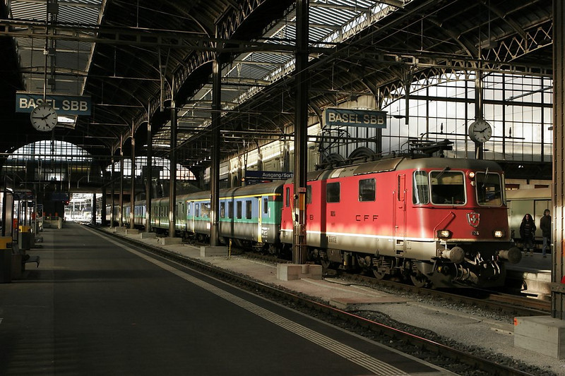 At Basel Swiss Station, a classic Re 4/4 II is beautifully illuminated inside the historic train shed.