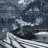 Automobiles are being shuttled through the Lötschberg Tunnel with these trains. A Re 4/4 arrives with a load at Kandersteg.