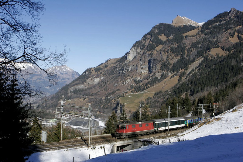 Splendid winter weather on the Lötschberg line as an Re 4/4 II heads upgrade.