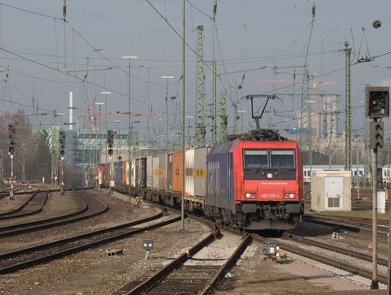 SBB Cargo 482 035 leads a container train from Germanythrough Basel Bad Bf towards Switzerland.
