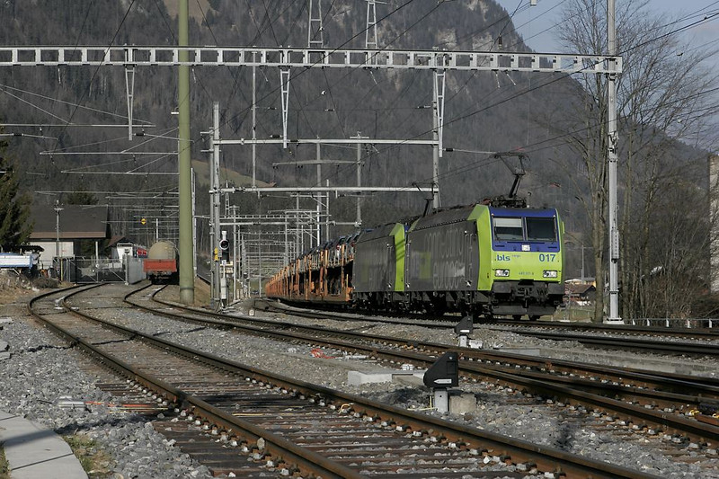 In the last shot from that location, BLS Cargo drags a solid train of Mercedes Benz B-class automobiles uphill.