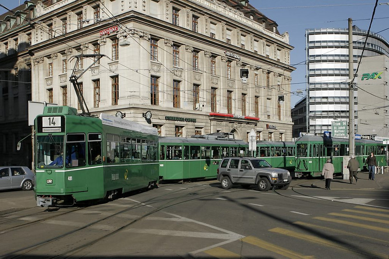 Basel - car drivers can easily get stuck between the pedestrians and trolleys zipping around. The classic green ad-free livery is timeless!