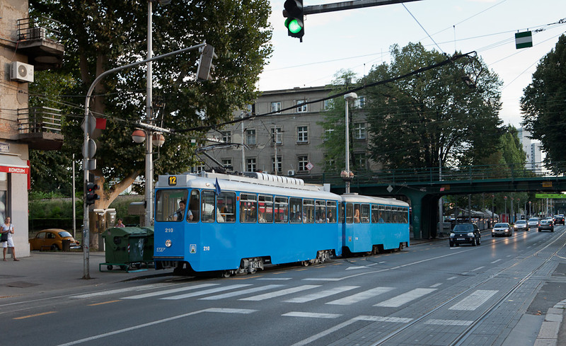 An example of the oldest trams running in 9/2011, ZET 210 drags trailer 718 uphill on line 12 shortly before the Vodnikova stop.