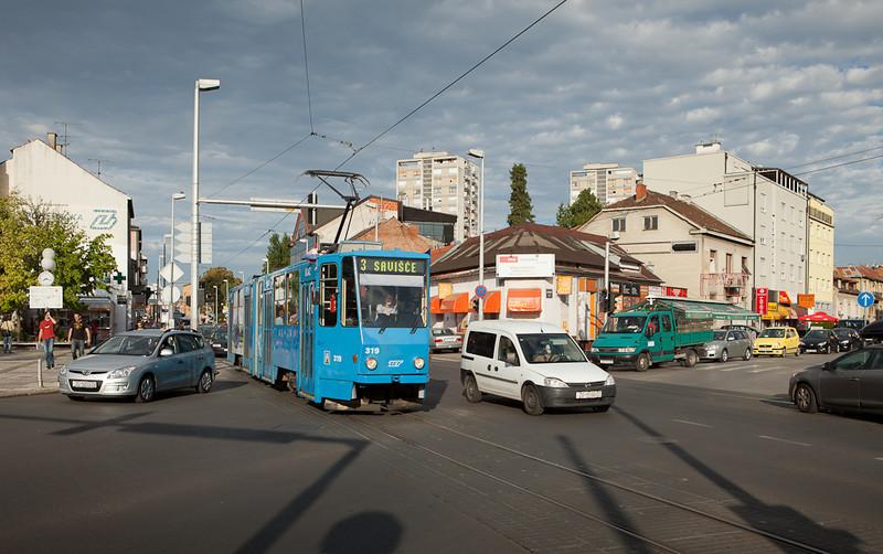 Tatra KT4YU 319 fights Monday morning rush hour traffic running on line 3 across Tresnjevka Trg.