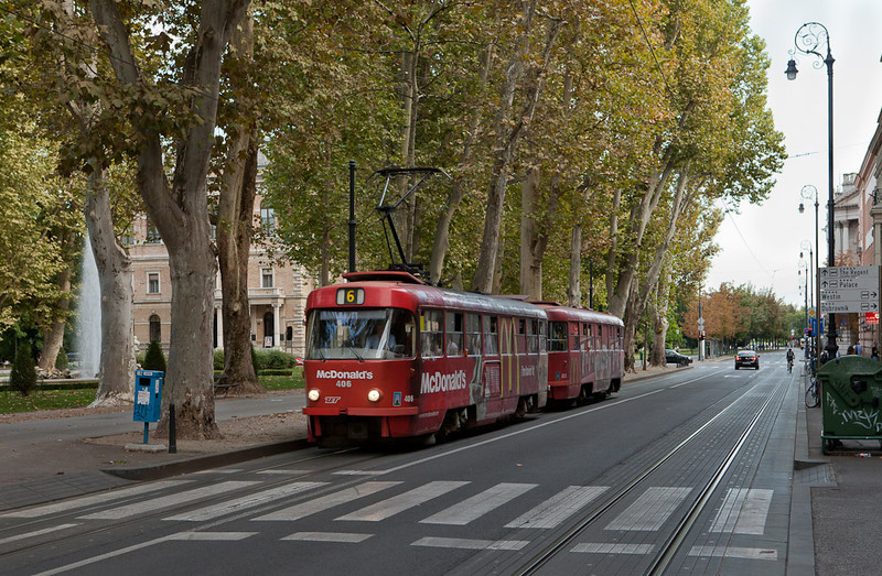 Tatra T4YU 406 and B4YU 823 on line 6 pass trees planted for the Kaiser over 100 years ago in Zrinjevac Park.
