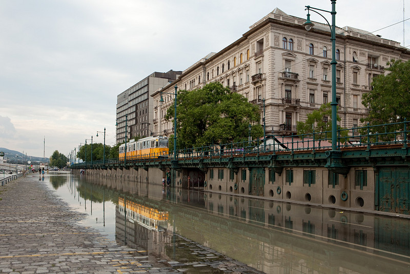 Budapest - Ganz CSMG2 as a service on line 2 passes the flooded Danube docks.
