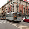 Milano - work car 714 with a flat car carrying curved rail sections on Via Vitruvio near Piazza Lima.