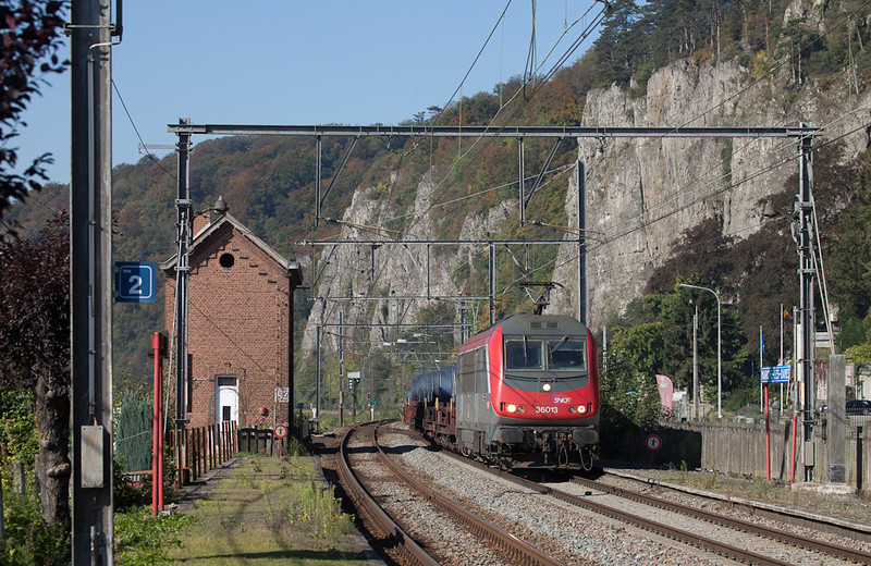 SNCF Fret Astride 36013 brings steel coils downriver through Marche-les-Dames.