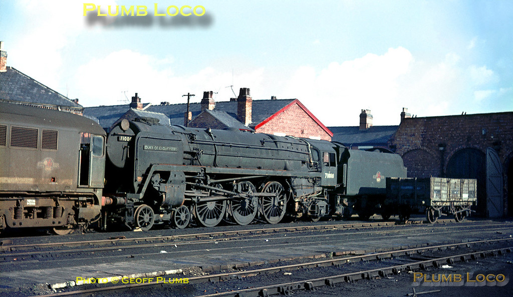 """The unique BR Standard 8P 4-6-2 No. 71000 """"Duke of Gloucester"""" in store outside the old Paint Shop at Crewe Works on Tuesday 2nd November 1965. The three cylinder  engine with Caprotti valve gear, built in 1954, had not been a great success and was an early casualty. The cylinders were removed and preserved in the Science Museum in South Kensington and the remainder of the engine ended up at in Woodham's yard at Barry. It was rescued as """"Mission Impossible"""" and is now a very successful performer on the main line again. Next to it is an unidentified member of a diesel class that also did not last long, the Metropolitan Vickers Co-Bo, number series D5700 - D5719. Introduced in 1958, one of the class is also preserved. Slide No. 1671."""