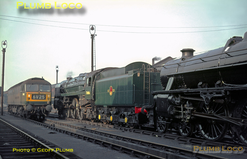 """A couple of ex-works locos stand on the steam test roads at Crewe Works - BR Standard """"Britannia"""" Class 4-6-2 No. 70006 """"Robert Burns"""" is newly repainted in plain green livery and has been shorn of its nameplates. Nearer camera is """"Black 5"""" 4-6-0 No. 45310 in plain black livery, while the dirtiest of the trio in the class 47 alongside. Identity is uncertain, but it could be D1662 """"Isambard Kingdom Brunel"""", later renumbered 47484. Friday 4th November 1966. Slide No. 2587."""