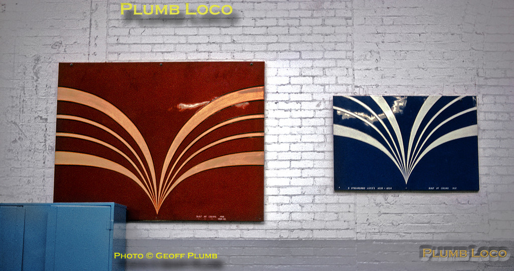 """Hanging on the wall of the """"new"""" paint shop at Crewe Works on Tuesday 14th February 1967 were these two panels, perhaps templates for the colour schemes for the streamlined Stanier Pacifics. On the left is the Maroon with Gold stripes livery, while on the right is the Blue with Silver stripes. This is marked """"Streamlined Locos 62xx - 62xx"""" and """"Built at Crewe 1937"""". The Maroon version also has """"Built at Crewe"""", though the date and numbers are not clear. Where these panels are now I have no idea! Slide No. 2696."""