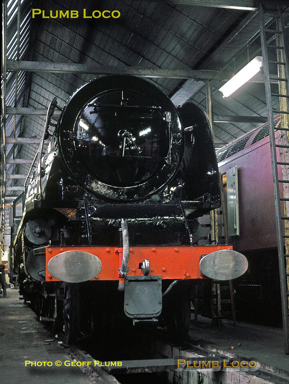 """Stanier 8P """"Coronation"""" Class 4-6-2 No. 46235 """"City of Birmingham"""" is in the old Paint Shop at Crewe Works in the process of being repainted in BR green livery prior to its preservation in the Birmingham Museum of Science and Industry. Most of the paintwork is complete, but the bufferbeam is still in undercoat. Alongside is a diesel still in primer paint. Wednesday 29th December 1965. Slide No. 1788."""
