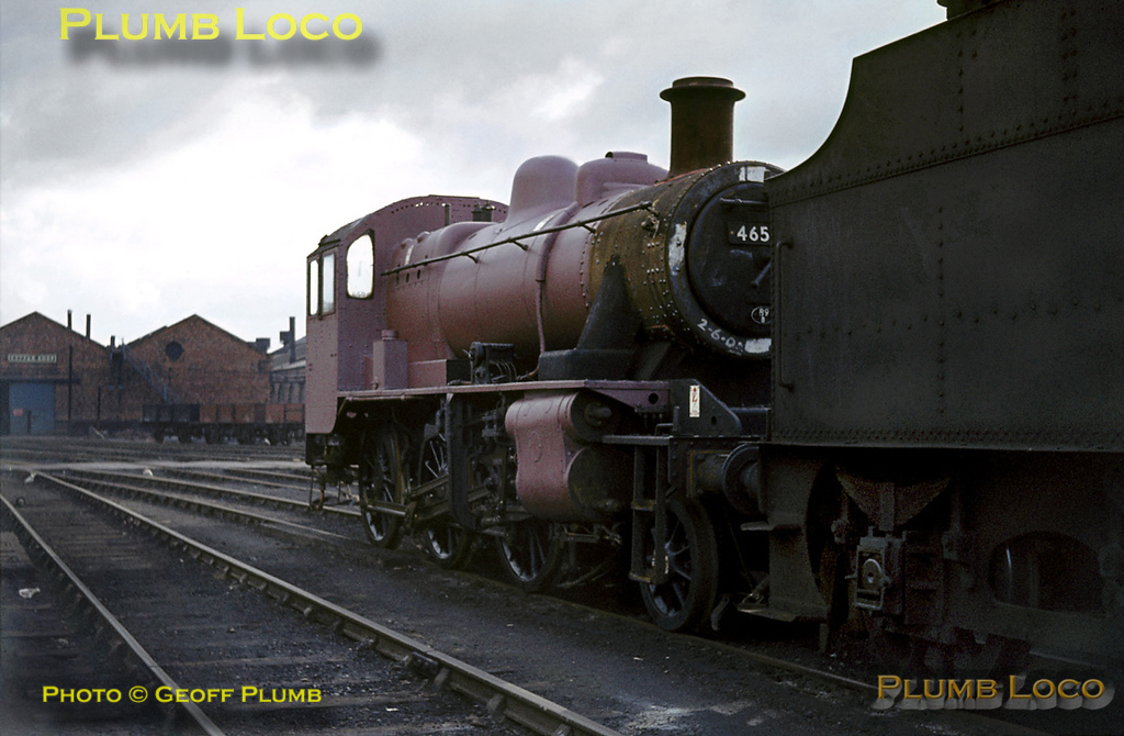LMS Ivatt 2-6-0 2MT No. 46509 has been undergoing maintenance at Crewe Works and so far has received just a coat of pink primer paint. After a full repaint and being reunited with its tender, it may return to the depot whose code it carries - 89B,  Brecon MPD. Sunday 13th October 1963. Slide No. 428.