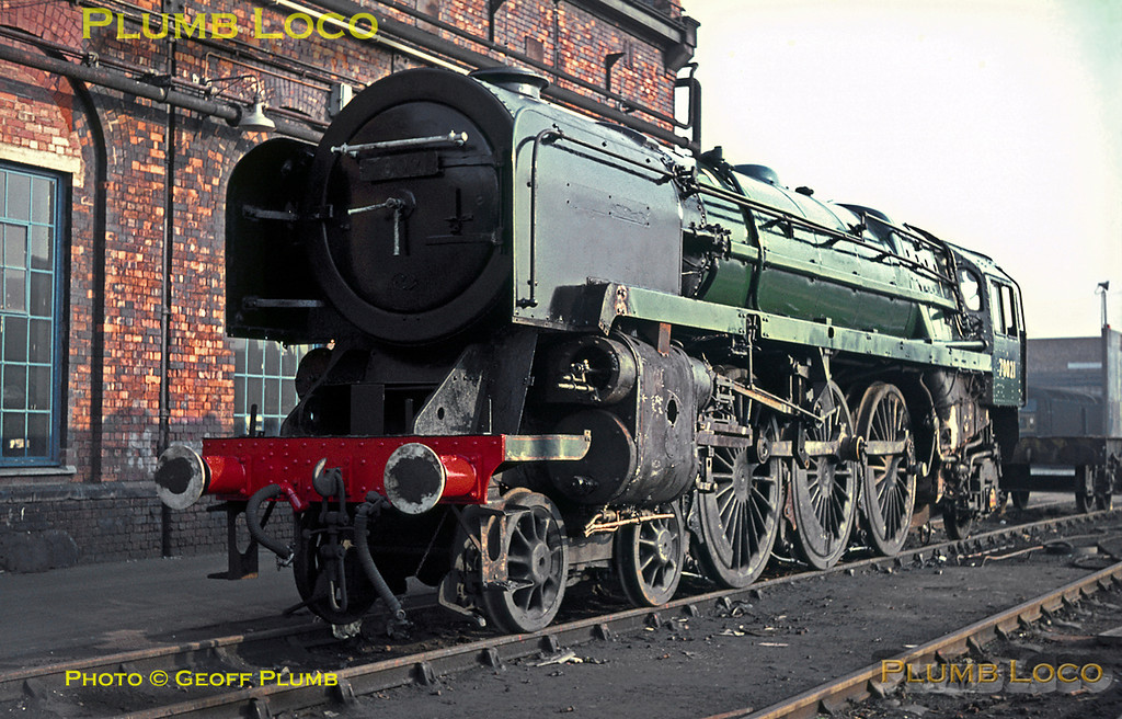 """BR Standard """"Britannia"""" Class 4-6-2 No. 70021 """"Morning Star"""" is at Crewe Works undergoing repairs. It is still partially stripped down, though has already been partly repainted into plain green livery. Its nameplates have been removed and were probably not refitted prior to its return to service. Friday 4th November 1966. Slide No. 2582."""