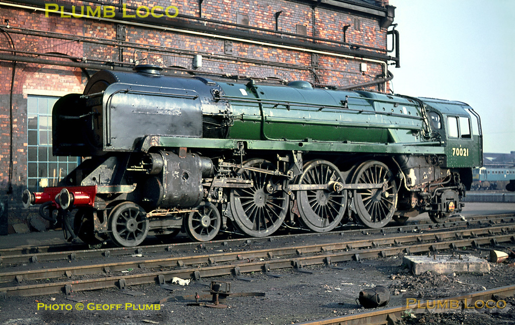 """BR Standard """"Britannia"""" Class 4-6-2 No. 70021 """"Morning Star"""" is at Crewe Works undergoing repairs. It is still partially stripped down, though has already been partly repainted into plain green livery. Its nameplates have been removed and were probably not refitted prior to its return to service. Friday 4th November 1966. Slide No. 2583."""