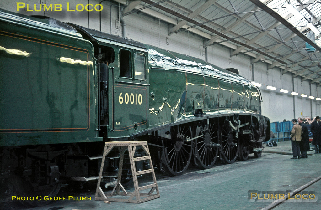 """Crewe Works. LNER A4 4-6-2 No. 60010 """"Dominion of Canada"""" has been through Crewe Works for attention and repainting into BR Brunswick Green livery prior to being shipped to Canada for preservation, here standing in the new Paint Shop. Nameplates and most of the motion still have to be refitted. Tuesday 14th February 1967. Slide No. 2693."""