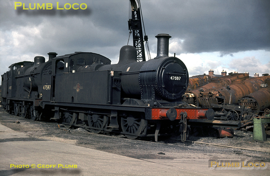 """LMS """"Jinty"""" 3F 0-6-0T No. 47597 is one of the works shunters at Crewe Works, here sitting out of use for the weekend by the boiler dump at the works. Behind is another of the shunters, 4F 0-6-0 No. 43957. This is one of the original Midland Railway series built from 1911, and appears to be a right-hand drive engine, the later LMS version being left-hand drive. Sunday 13th October 1963. Slide No. 430."""