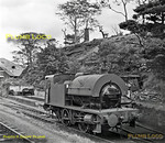 """Despite its ancient appearance, 0-4-0ST No. 47007 was built in 1953 as an updated version of the original Kitson design to Stanier's requirements built in 1932. It is standing alongside the remains of the one loco engine shed at Sheep Pasture on the Cromford & High Peak line, at the top of Sheep Pasture Incline. It worked trains along the level section (more or less!) to the bottom of the Middleton Incline, where once again rope-haulage took over for the ascent. The remains of the winding engine house at Sheep Pasture are still extant and much of the former railway is now the """"High Peak Trail"""" footpath. Sunday 12th August 1962. B&W Neg No. 133."""