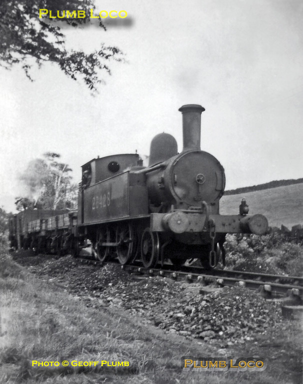 """From the Geoff Plumb Collection. Ex-LNWR """"Chopper"""" 2-4-0T No. 26428 was the last of its class and employed on the Cromford & High Peak line. Soon after being renumbered it is seen with a permanent way works train on the line between Black Rocks and Sheep Pasture, possibly in September 1947. Photo by Derek Plumb."""