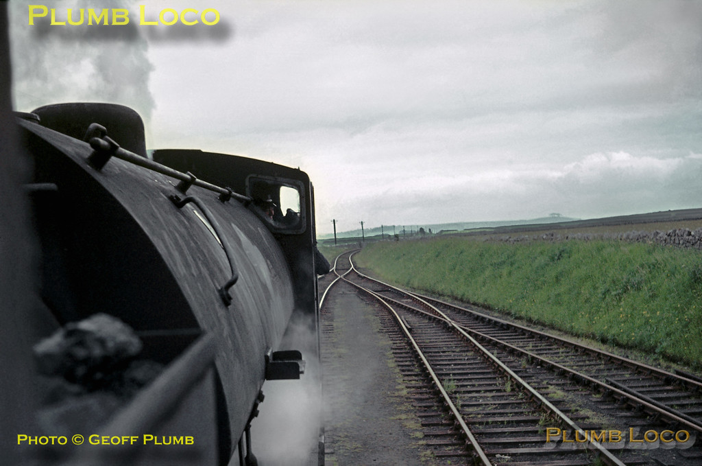 """Seen from the footplate of 68012, fellow J94 0-6-0ST No. 68079 is the pilot engine for the RCTS """"High Peak Railtour"""" as it passes through Friden on the Cromford & High Peak line, en route from Parsley Hay to Middleton Top. Saturday 27th June 1964. Slide No. 739."""