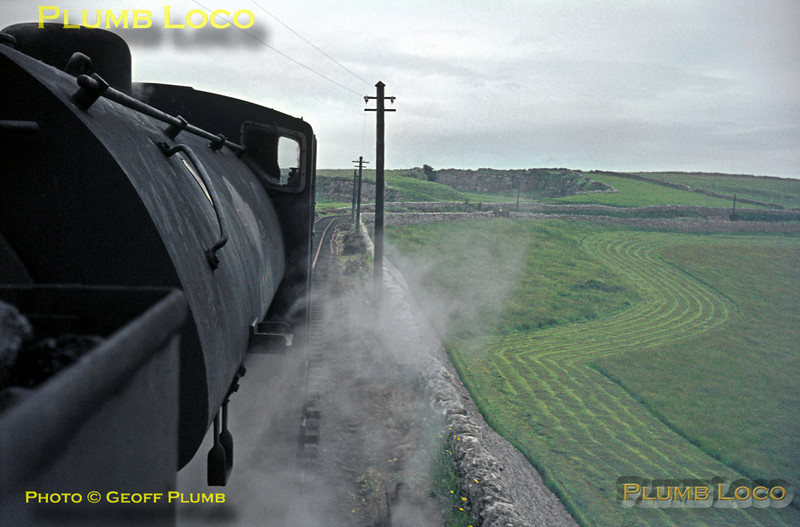 "View from the footplate of 68012 double-heading with 68079 as they cross the stone embankment at Minninglow, en route from Parsley Hay to Middleton Top with the RCTS ""High Peak Railtour"" on Saturday 27th June 1964. Slide No. 743."