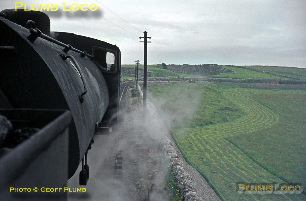 """View from the footplate of 68012 double-heading with 68079 as they cross the stone embankment at Minninglow, en route from Parsley Hay to Middleton Top with the RCTS """"High Peak Railtour"""" on Saturday 27th June 1964. Slide No. 743."""