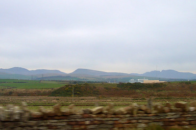 Leaving Sellafield, and looking across eastwards to some of the Western Fells of Lakeland, including Haycock, Seatallan and the Scafells on the right, the cleft of Mickledore pass clearly visible, separating Scafell Pike and Scafell.