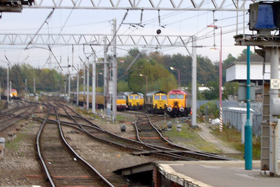 A blurry photo, but a busy scene at Carlisle - 57311 Parker approaches with some timber wagons as 31459 and 31190 on the test train, 66511, 31190, 66513 and 57316 FAB 1 sit in High Wapping sidings.