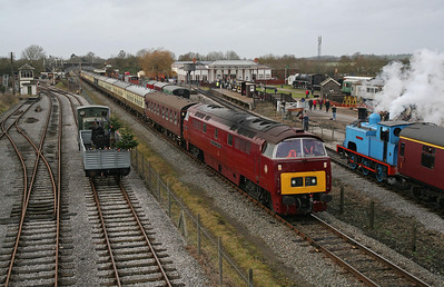 Flanked by Hunslet 0-4-0DM no. 2067 and North British 0-6-0T 'Coventry No.1' on Santa Special duties, D1015 waits on the track of the ex-Great Central main line at the Buckinghamshire Railway Centre, Quainton Road with the stock of Pathfinder Tours' 'Maybach Meanderer' from Crewe.