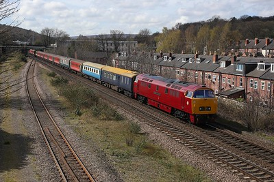 On its first outing of 2016, D1015 sweeps through the southern suburbs of Sheffield (alongside Heeley loop) working the 'Western Yorky' from Derby to York. At the rear of the train is 67015, beyond which lie the remains of Millhouses shed. 10/4/15