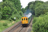 """6 car Thumper 1001 is seen rounding the curve at Silchester near Basingstoke on 1Z92 Poole-Hastings """"The Andy Piper & Grant Tyron memorial railtour"""". Having climbed the bank from Basingstoke it made a fine sight & sound<br /> in the poor weather 07 August."""